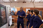 manufacturing employees being trained on the shop floor